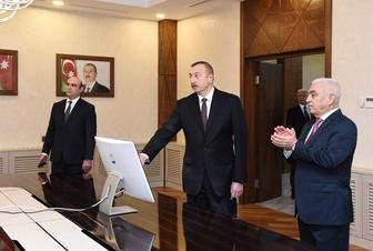 President Aliyev attends opening of Baku distribution network's building